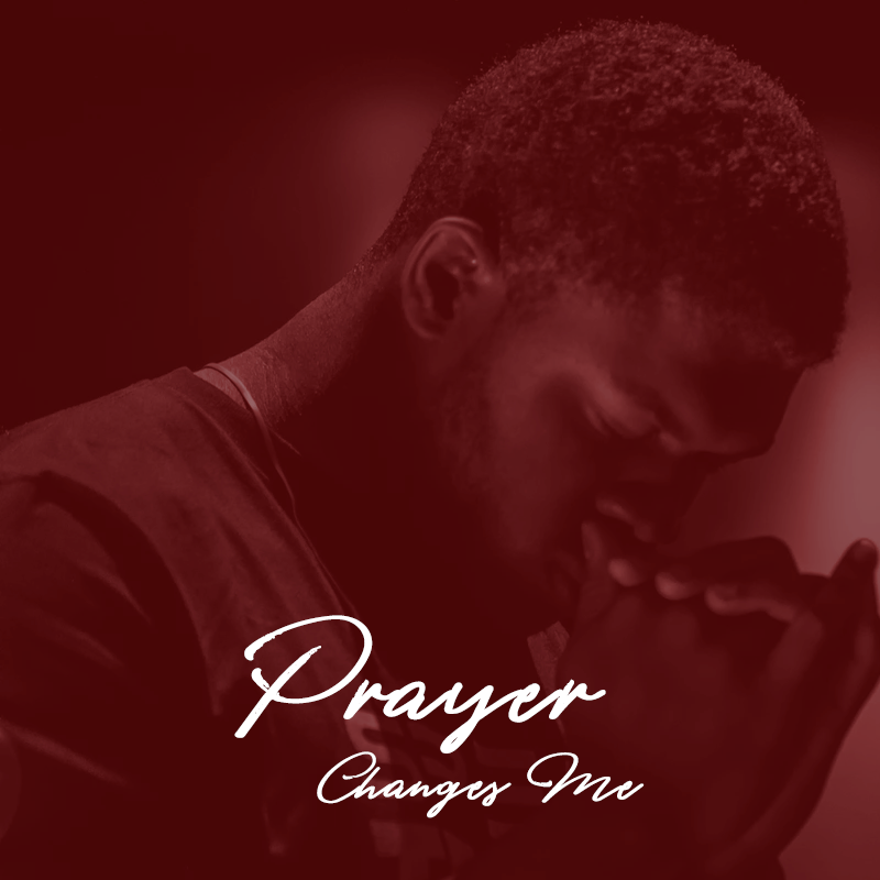 """Man praying with the words """"Prayer Changes Me"""""""