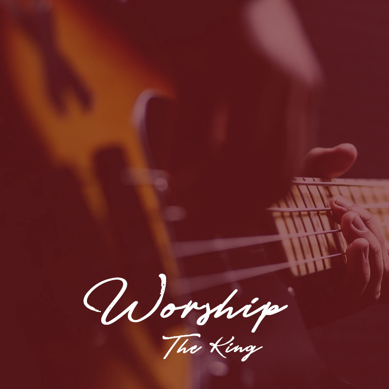 """A man playing a guitar with the wors """"Worship the King"""""""